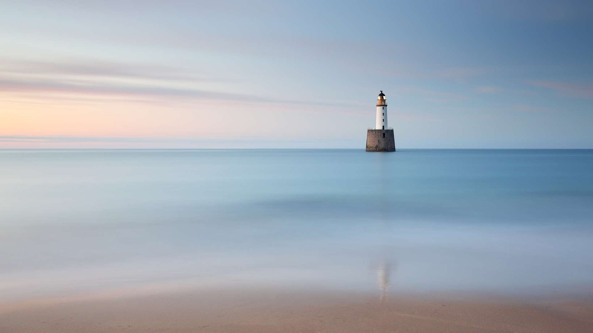 A lighthouse and a body of water