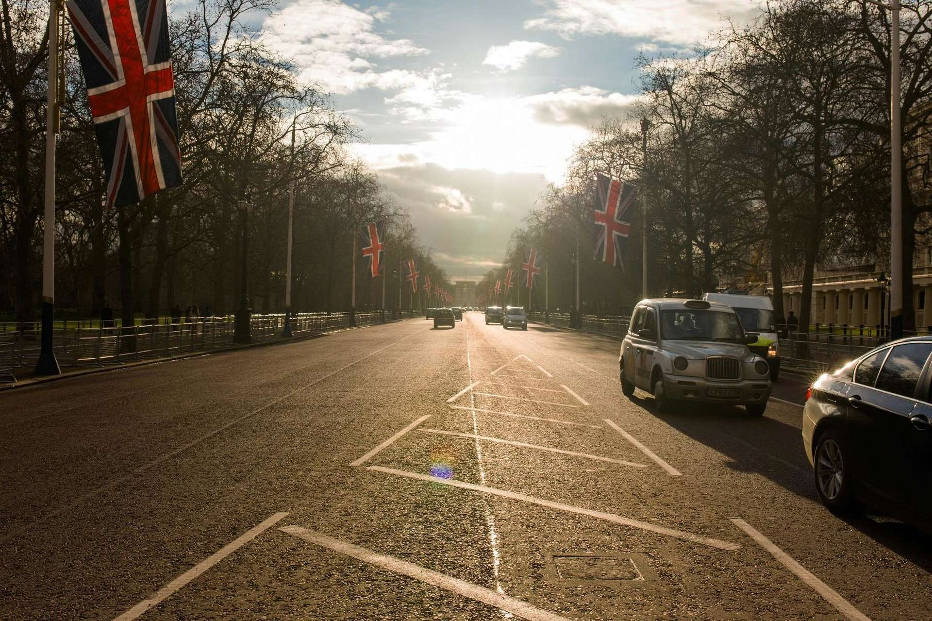 London street with taxi and flags