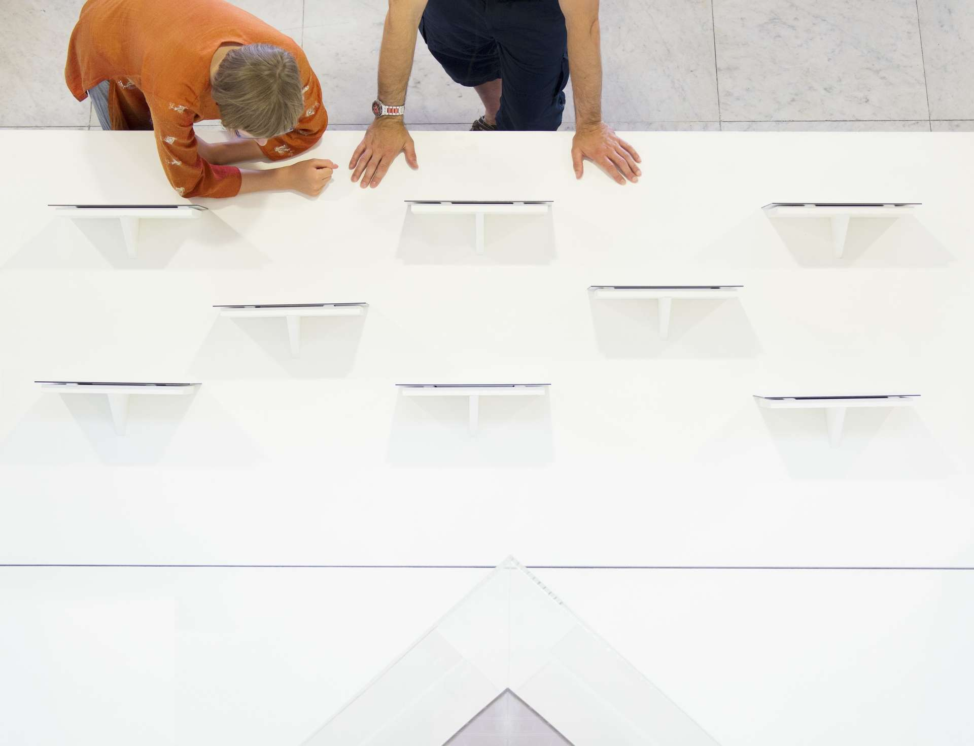 Aerial view of people looking at tablets